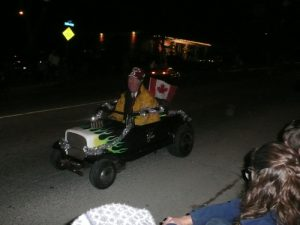 Shriner in mini-car during parade