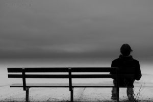 solitary figure on a bench
