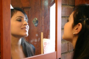 image of woman looking in mirror